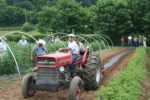 ASD director Anthony Flaccavento drives a tractor during a farm tour