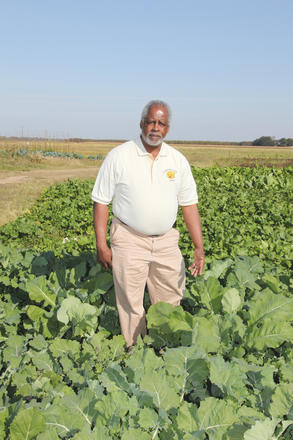 Leslie Glover standing in a field.