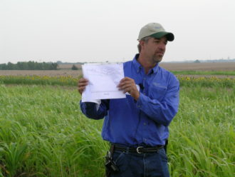 Brian Berns holding a data chart during a field day.