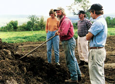 Jack Lazor of Butterworks Farm in Westfield, Vt., shows the end product of composted dairy manure, which he uses to build soil organic matter, during one of his popular pasture walks.