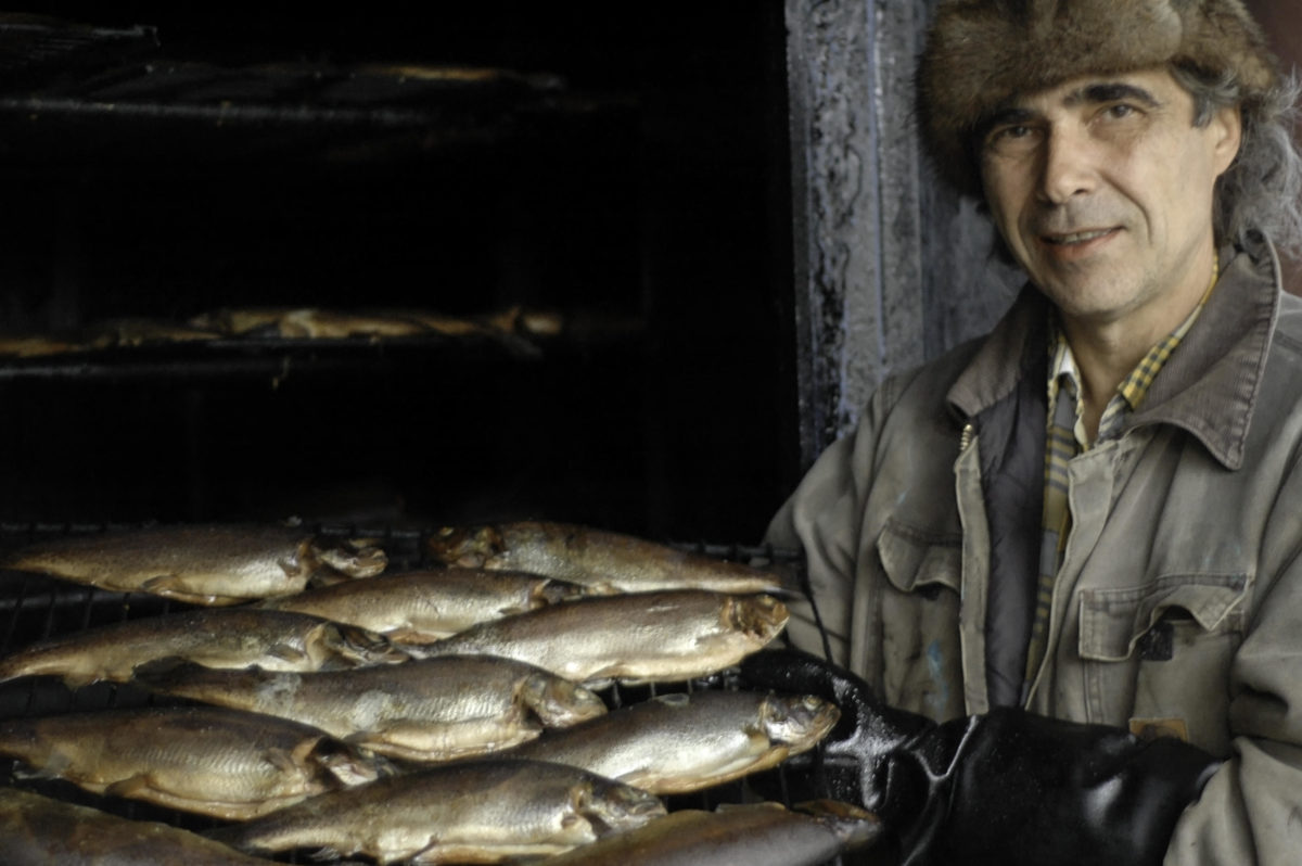 Man and smoked trout