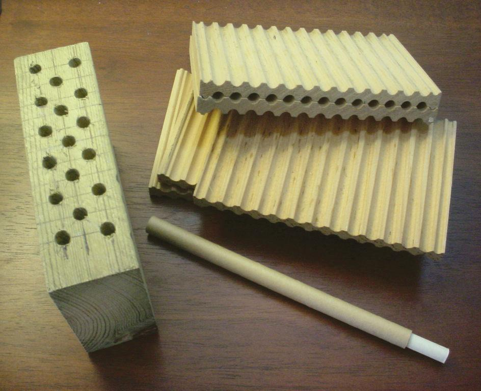 Nest options including drilled wooden blocks, grooved boards, and cardboard tubes.