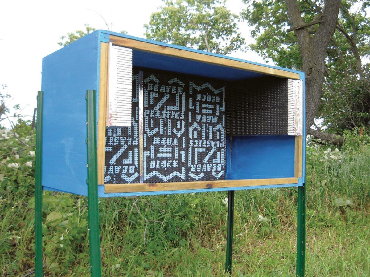 Homemade shelter holding a series of nest blocks.