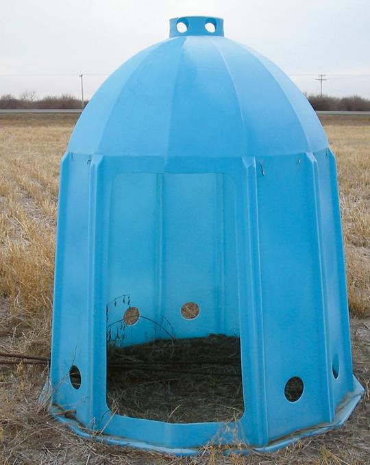 Tent-like manufactured bee shelter.