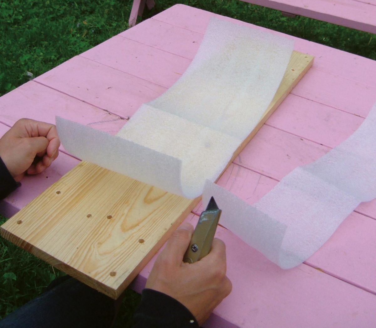 Backing material (closed-cell packing foam) being cut.