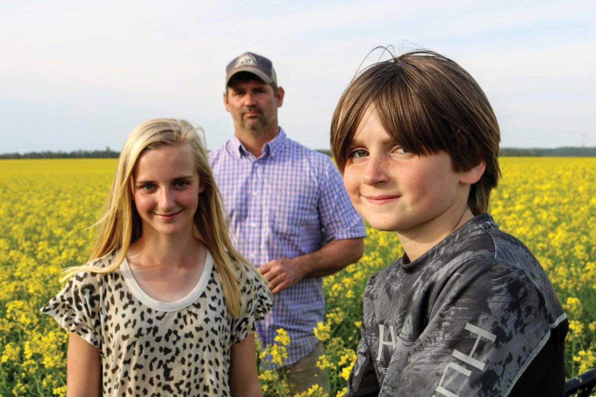 Farmer posing with his children
