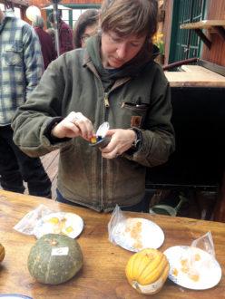 Jennifer Surdyk measures the Brix value of squash
