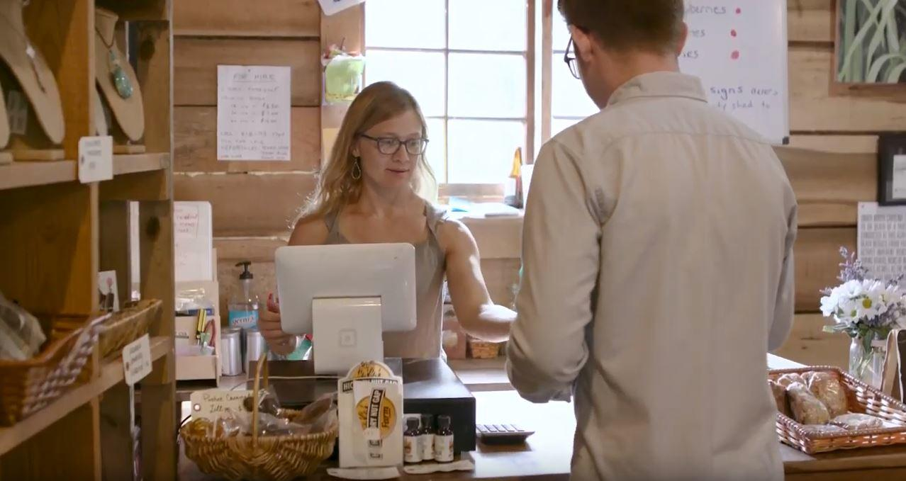 Woman at register with customer
