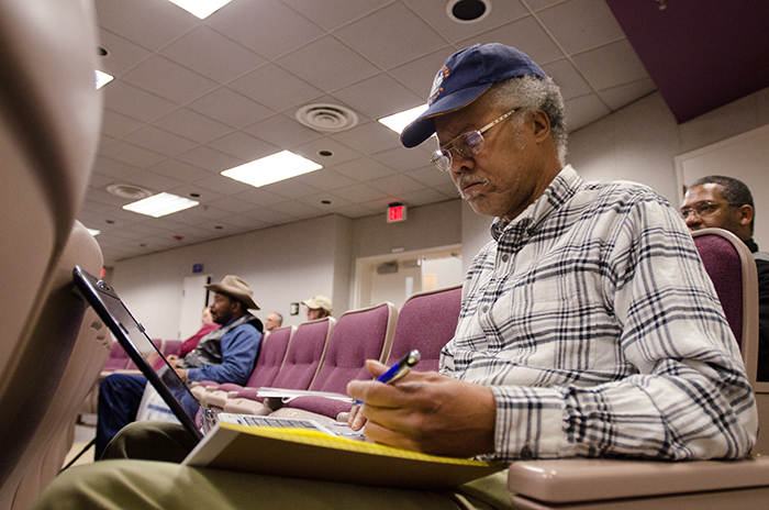 farmer taking notes at a workshop