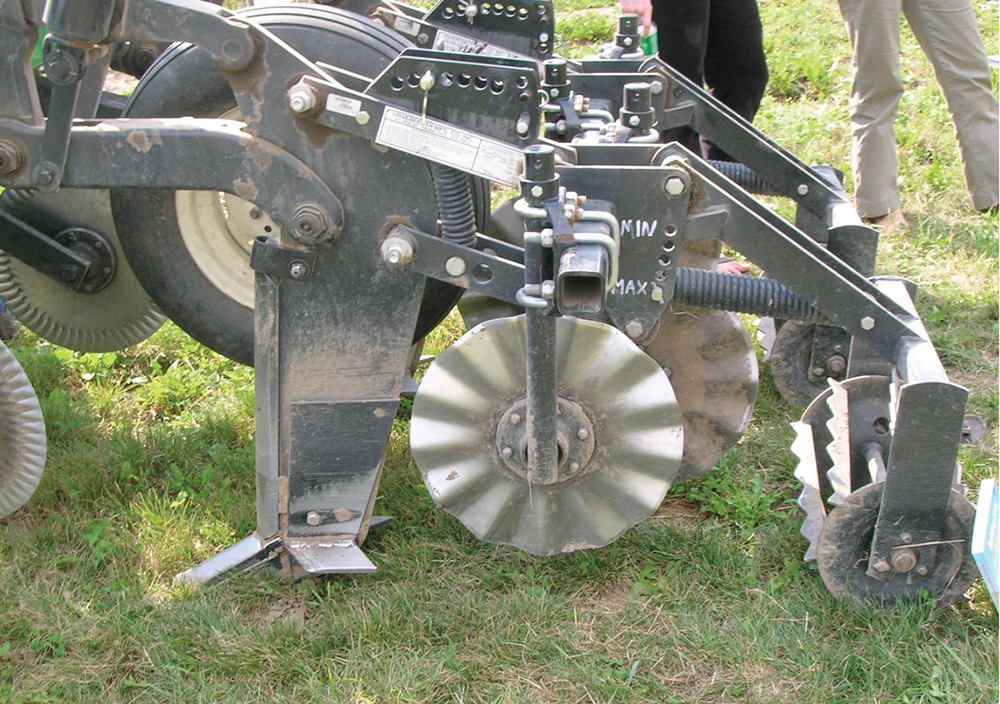 strip-till tool with hilling disks and rolling basket